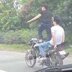 Man surfs motorcycle