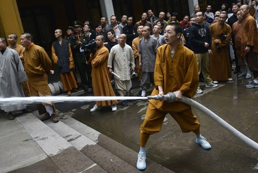 Monks and priests fight fire