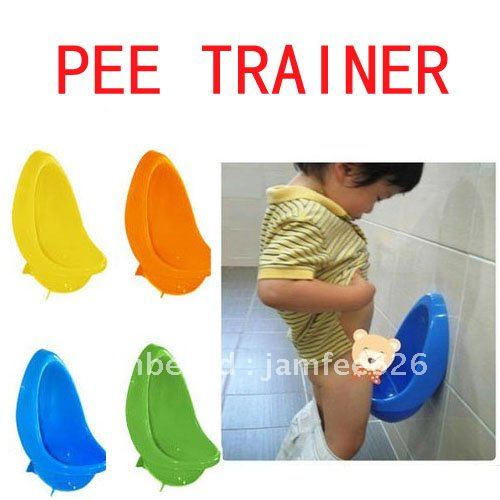 Toddler peeing into trainer urinal