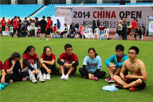 Ivan Xu (far right), sitting with the Ultimate Frisbee team he created in Wuhan, CUG, after it won its first-ever tournament, China Open 2014