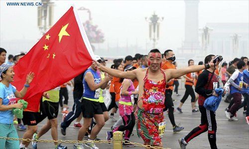 Beijing Marathon 2014 nationalistic runner