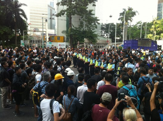 Hong Kong Occupy and anti-Occupy protesters shout at one another