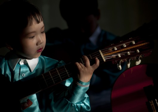 Young Boy Playing Guitar, Chongjin, North Korea
