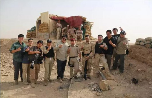Chinese film crew with Kurdish forces